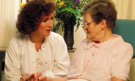 Nurse talks with elderly female patient