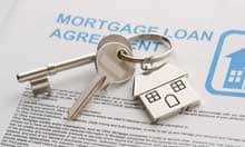 House keys on a mortgage agreement