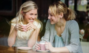 Two women having a cup of coffee in a cafe.