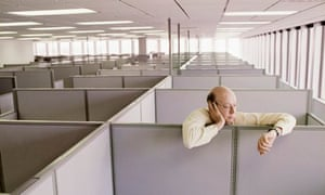 A man alone in an open-plan office