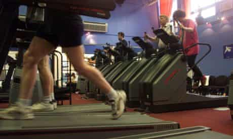 People on running machines in a gym