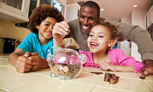 Father, children and piggy bank