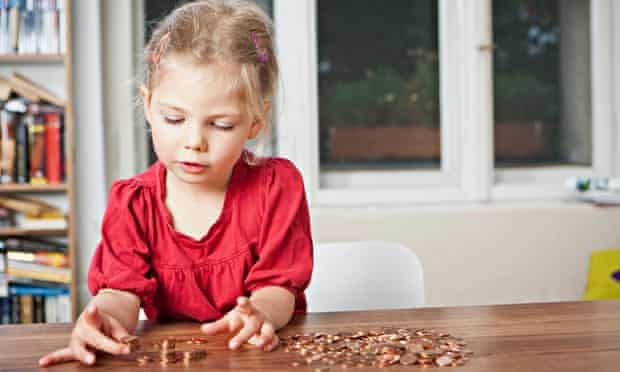 Girl playing with pennies at table