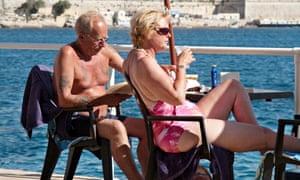Elderly british couple sunbathing in Valletta, Malta