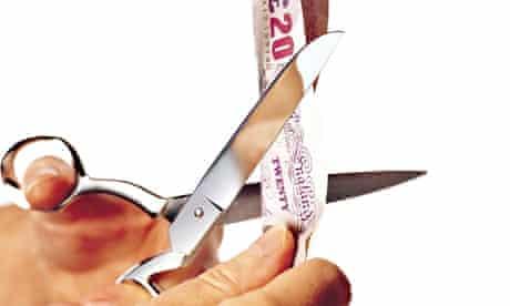 scissors cutting 20 pound note