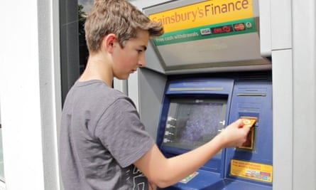 young boy uses debit card