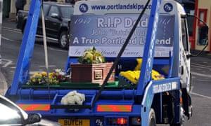 coffin on skip truck