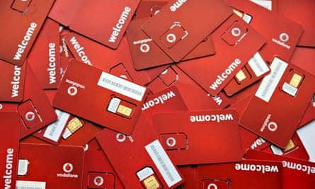 Pile of Vodafone  SIM cards