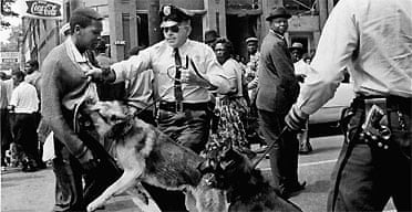 A 17-year-old civil rights demonstrator, defying an anti-parade ordinance of Birmingham, Alabama, USA, America is attacked by a police dog on May 3, 1963