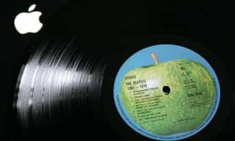 A Beatles record with an Apple Corps logo on top of an Apple computer