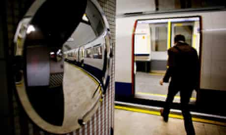 A man gets into a London Underground tube train