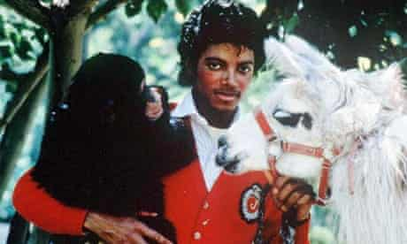 Michael Jackson poses with his pets in 1983