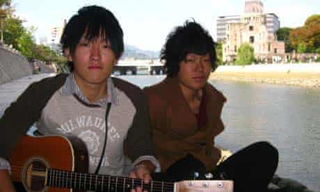 Japanese musicians performing on the Ota river in Hiroshima