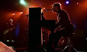 Chris Martin plays a gig