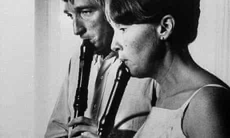 John Updike and his wife playing recorders