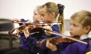 Children playing musical instruments in Scotland