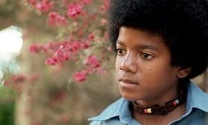 Young Michael Jackson in a garden