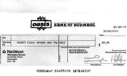 Oasis cheque signed by Noel and Liam Gallagher