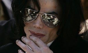 Michael Jackson waves as he leaves the Santa Barbara County Court