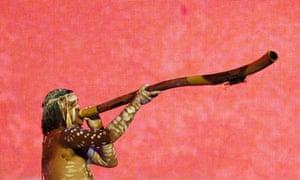 An Australian aborigine perfroms with a didgeridoo
