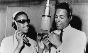 Stevie Wonder and Marvin Gaye at the microphone in Motown's Detroit recording studio in 1965.