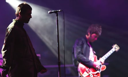 Liam (left) and Noel Gallagher of Oasis perform in Germany in July 2009