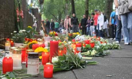 People mourn the stampede victims