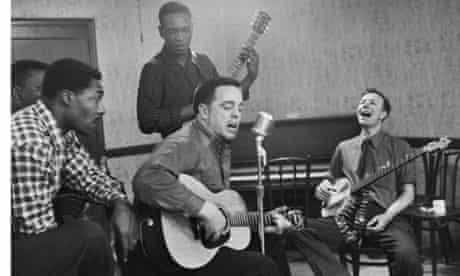 American musician and musicologist Alan Lomax (second right)