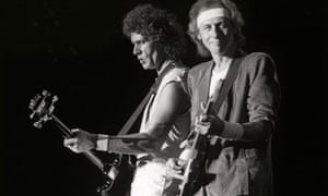 John Illsley and Mark Knopfler from Dire Straits perform live on stage at Ahoy, Rotterdam, Holland