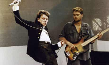 Adam Clayton and Bono performing live onstage at Live Aid, 13 July 1985
