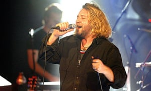 Russell Crowe performs with 30 Odd Foot of Grunts