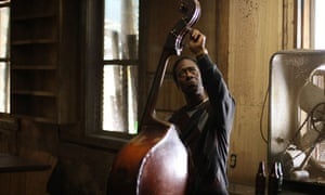 Clarke Peters in Treme tunes a double-bass