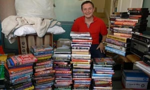 Mike Finch with hundreds of 90s rave tapes in a still from the film Tape Crackers
