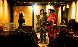 Three members of Ultrasound singing in a sound studio