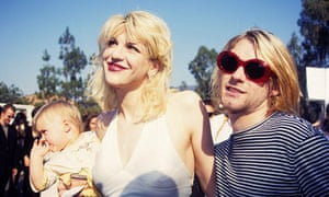 Kurt Cobain with Courtney Love and their daughter, Frances Bean Cobain, in 1993.