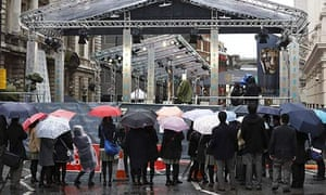 Baftas 2013: film fans stand in the rain