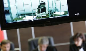 Pussy Riot member Maria Alyokhina testifies via video link during her parole hearing on Wednesday.