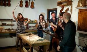 Emma John learns to play the stradivarius