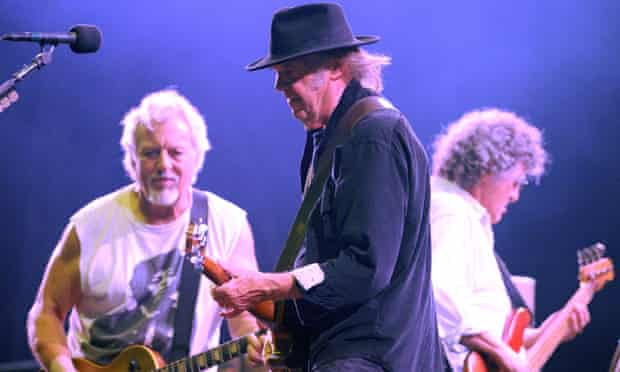 Neil Young, centre, onstage with Crazy Horse's Frank 'Poncho' Sampedro, left, and Billy Talbot in Ju