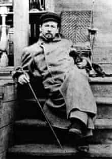 Anton Chekhov with his dachshund Quinine in 1897.
