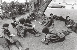 Howard Bingham photos: A group of Black Panthers relax in a park in Oakland, California