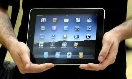 A customer poses with iPad