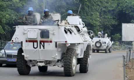 United Nations peacekeepers patrol around the Golf Hotel in Abidjan