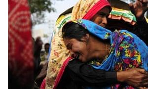 A woman cries at the Hamim Group garment factory