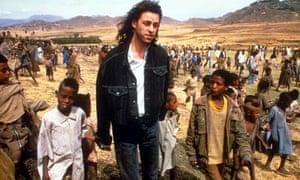 Bob Geldof with children in Africa, 1985.