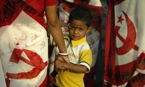 An Indian boy gestures in Kolkata