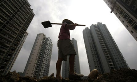 A Chinese worker makes his way along a c