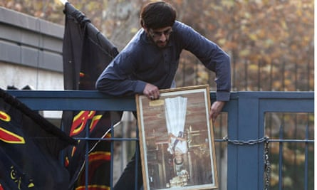 An Iranian protester storms the British embassy in Tehran