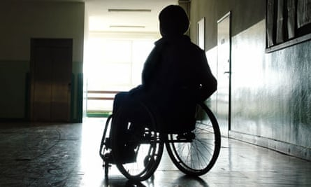Silhouette of woman in wheelchair