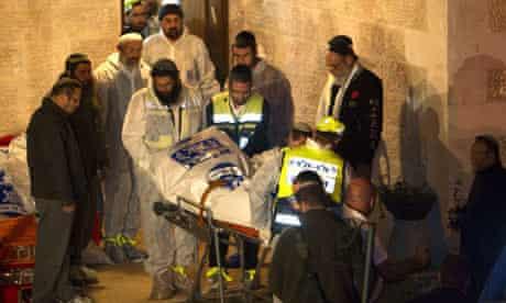 Israeli medics and Zaka volunteers carry